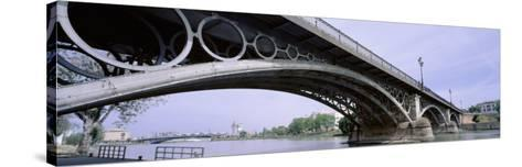 Low Angle View of Isabel II Bridge Over Guadalquivir River, Seville, Spain--Stretched Canvas Print