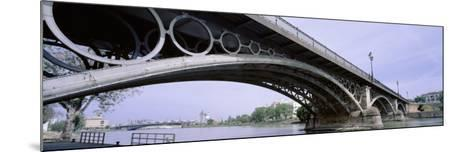 Low Angle View of Isabel II Bridge Over Guadalquivir River, Seville, Spain--Mounted Photographic Print