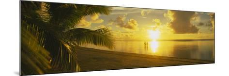Silhouette of a Couple Standing on the Beach, Aitutaki, Cook Islands, French Polynesia--Mounted Photographic Print