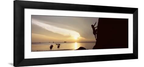 Silhouette of a Man Climbing a Rock, Railay Beach, Krabi, Thailand--Framed Art Print