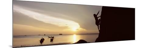 Silhouette of a Man Climbing a Rock, Railay Beach, Krabi, Thailand--Mounted Photographic Print