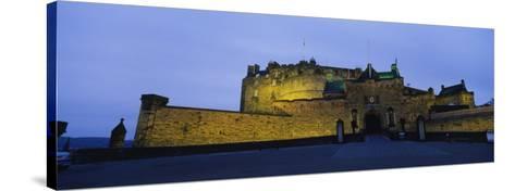 Castle Lit Up at Dusk, Edinburgh Castle, Edinburgh, Scotland, United Kingdom--Stretched Canvas Print