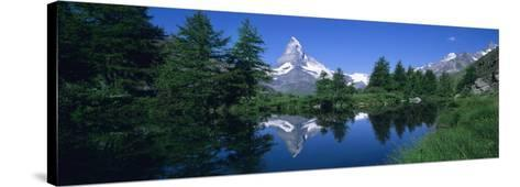 Reflection of a Snow Covered Mountain in a Lake, Grindjisee, Matterhorn, Zermatt, Switzerland--Stretched Canvas Print