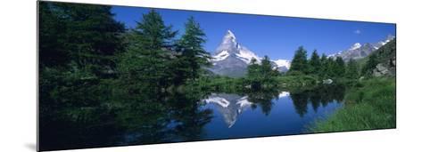 Reflection of a Snow Covered Mountain in a Lake, Grindjisee, Matterhorn, Zermatt, Switzerland--Mounted Photographic Print