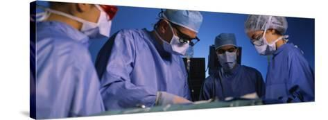 Four Surgeons in an Operating Room, Hospital--Stretched Canvas Print