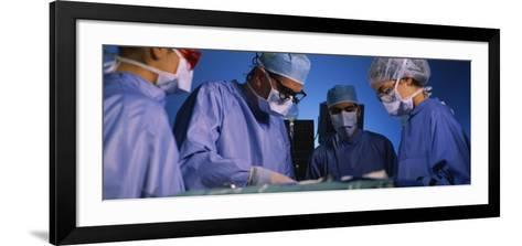Four Surgeons in an Operating Room, Hospital--Framed Art Print