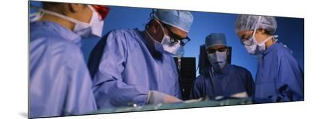 Four Surgeons in an Operating Room, Hospital--Mounted Photographic Print
