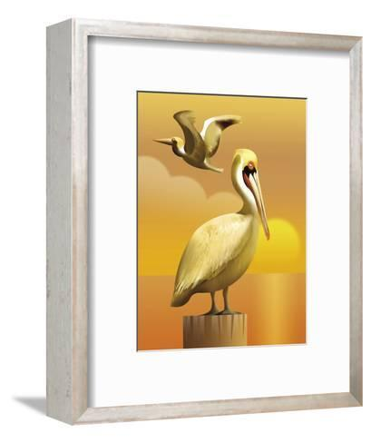 A View of Two Pelicans, One Standing on a Post and One Flying--Framed Art Print