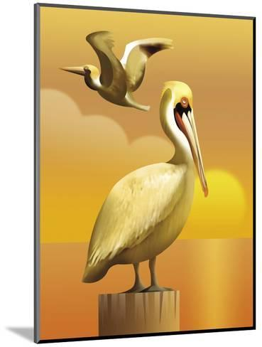 A View of Two Pelicans, One Standing on a Post and One Flying--Mounted Art Print
