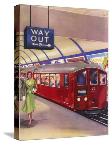 District Line Train in the Standard Red Colour on Its Way to Morden Southwest London--Stretched Canvas Print