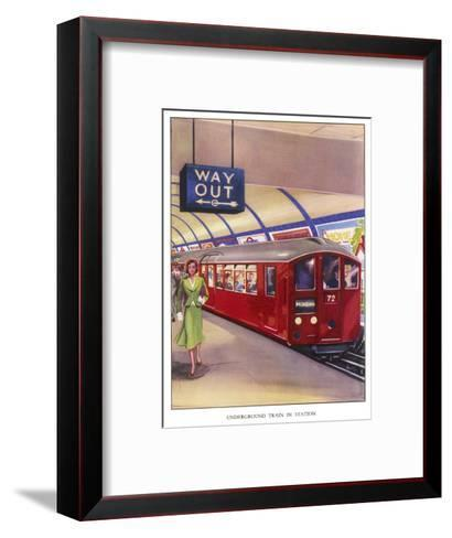 District Line Train in the Standard Red Colour on Its Way to Morden Southwest London--Framed Art Print
