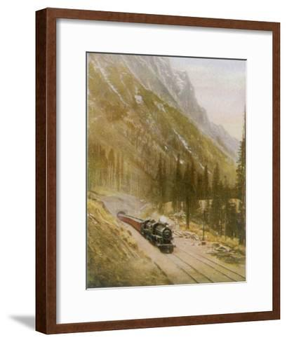 Canadian Pacific Railway Train Emerges from the Connaught Tunnel in the Selkirk Mountains--Framed Art Print