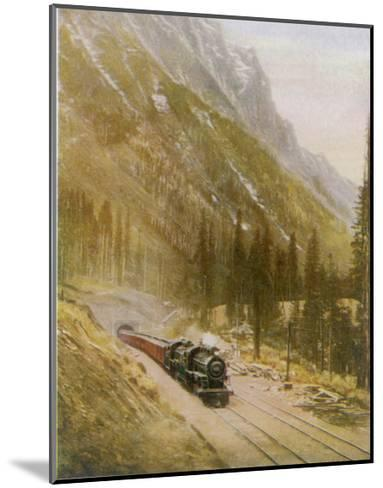 Canadian Pacific Railway Train Emerges from the Connaught Tunnel in the Selkirk Mountains--Mounted Giclee Print