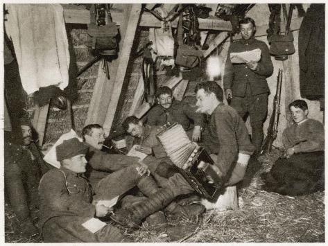 British Soldiers off Duty Smoking and Listening to an Accordion at the Front Somewhere in Flanders--Stretched Canvas Print