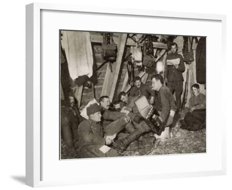 British Soldiers off Duty Smoking and Listening to an Accordion at the Front Somewhere in Flanders--Framed Art Print