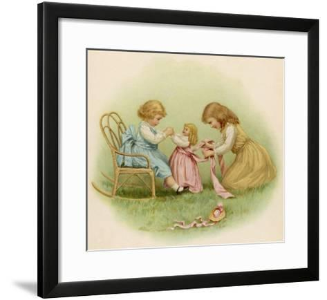 Doll is Dressed by Two Girls One in Front of Her While the Other Ties Her Sash Behind-Ida Waugh-Framed Art Print
