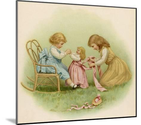 Doll is Dressed by Two Girls One in Front of Her While the Other Ties Her Sash Behind-Ida Waugh-Mounted Giclee Print
