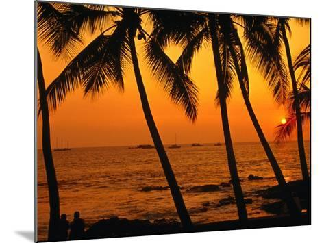 A Couple in Silhouette, Enjoying a Romantic Sunset Beneath the Palm Trees in Kailua-Kona, Hawaii-Ann Cecil-Mounted Photographic Print
