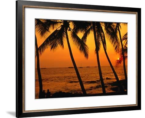 A Couple in Silhouette, Enjoying a Romantic Sunset Beneath the Palm Trees in Kailua-Kona, Hawaii-Ann Cecil-Framed Art Print