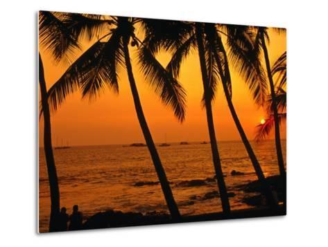 A Couple in Silhouette, Enjoying a Romantic Sunset Beneath the Palm Trees in Kailua-Kona, Hawaii-Ann Cecil-Metal Print