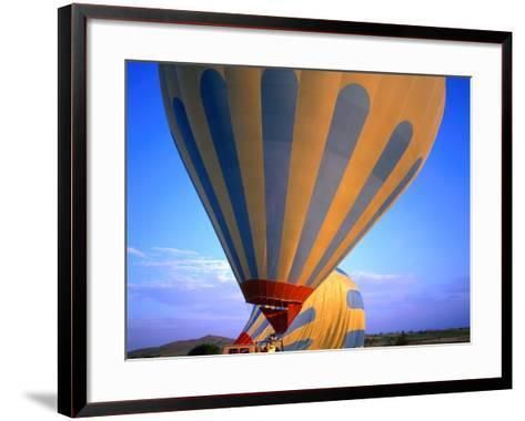 A Hot Air Ballon About to Fly Over the Cappadocia Landscape, Cappadocia, Nevsehir, Turkey-Wes Walker-Framed Art Print