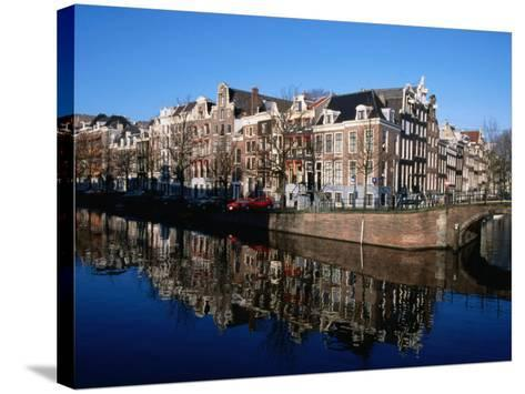 Buildings along Keizersgracht Reflected in Canal, Southern Canal Belt, Amsterdam, Netherlands-Martin Moos-Stretched Canvas Print