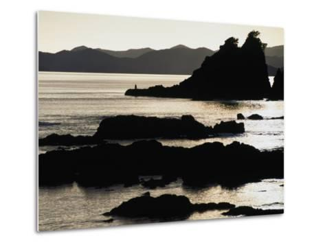 Lone Fisherman on Rocks at Sunrise in Russell, Bay of Islands, Northland, New Zealand-Stephen Saks-Metal Print