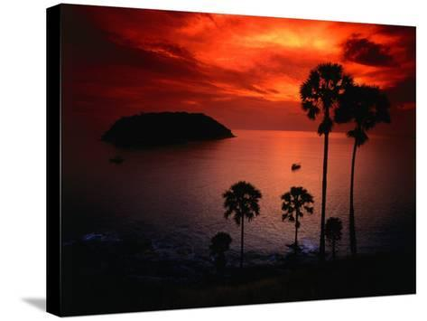 A Fiery Tropical Sunset at Prohmthep Cape, Phuket, Thailand-Anders Blomqvist-Stretched Canvas Print