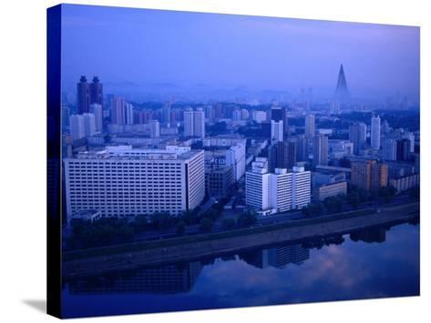 City Skyline from 17 Yanggakdo Hotel, P'Yongyang, North Korea-Tony Wheeler-Stretched Canvas Print