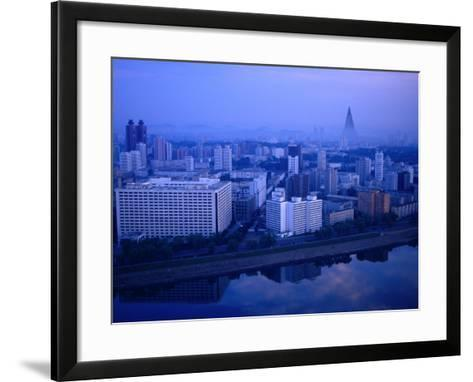 City Skyline from 17 Yanggakdo Hotel, P'Yongyang, North Korea-Tony Wheeler-Framed Art Print