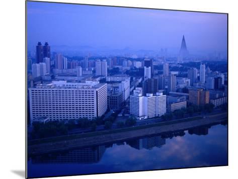 City Skyline from 17 Yanggakdo Hotel, P'Yongyang, North Korea-Tony Wheeler-Mounted Photographic Print