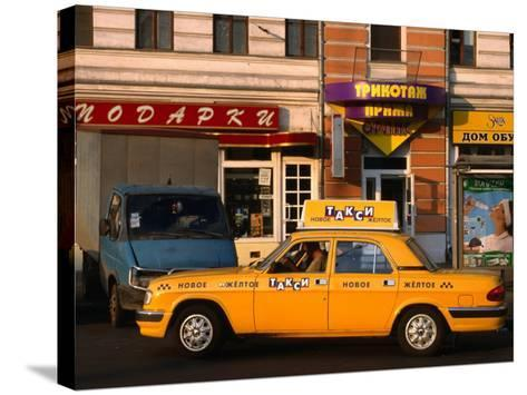 New Yellow Taxi in the Street, Moscow, Russia-Jonathan Smith-Stretched Canvas Print
