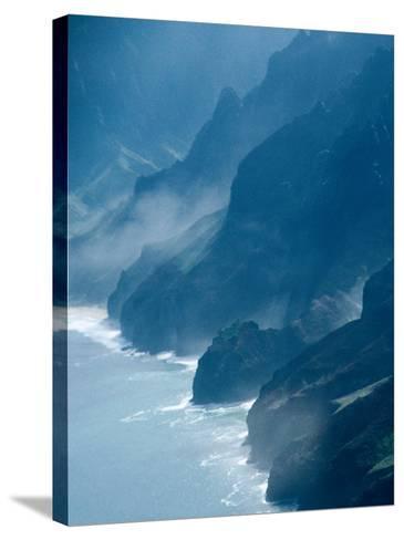 Mist on Rocky Coastline, Kauai, Hawaii, USA-Eric Wheater-Stretched Canvas Print