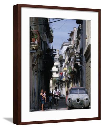 Woman with Baby, Man on Bicycle and Old Car in a Narrow Street Lined with Houses, Havana, Cuba-Rick Gerharter-Framed Art Print