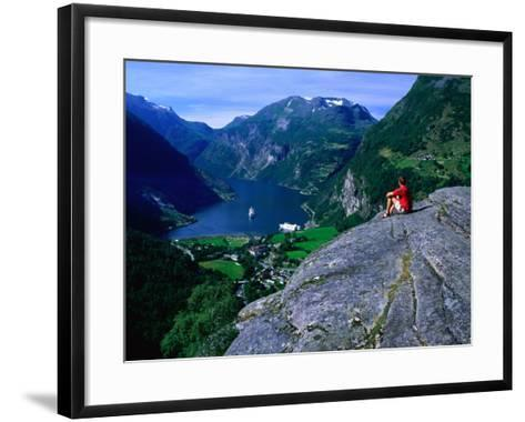 Man Resting on Rock Watching Cruise Ship Sail Out of Geirangerfjord, Geiranger, Norway-Anders Blomqvist-Framed Art Print