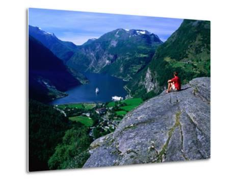 Man Resting on Rock Watching Cruise Ship Sail Out of Geirangerfjord, Geiranger, Norway-Anders Blomqvist-Metal Print