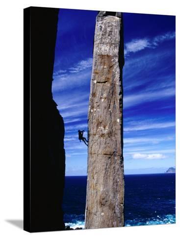 Rock-Climber Ascending the Totem Pole Rock Stack on the Tasman Peninsula, Australia-Grant Dixon-Stretched Canvas Print