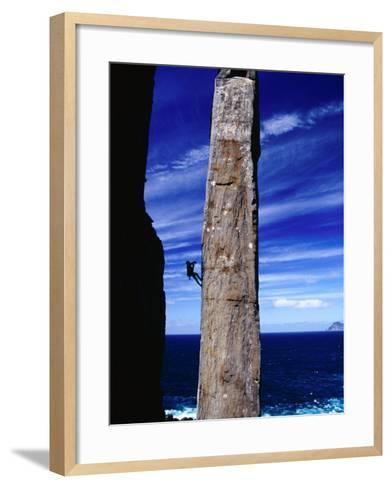 Rock-Climber Ascending the Totem Pole Rock Stack on the Tasman Peninsula, Australia-Grant Dixon-Framed Art Print