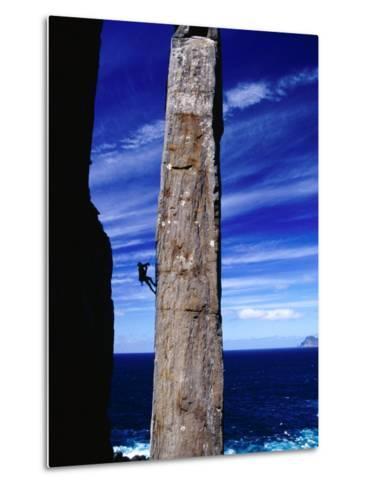 Rock-Climber Ascending the Totem Pole Rock Stack on the Tasman Peninsula, Australia-Grant Dixon-Metal Print