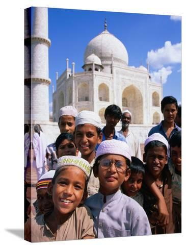 Group of Boys with Taj Mahal in Background, Looking at Camera, Agra, India-Paul Beinssen-Stretched Canvas Print