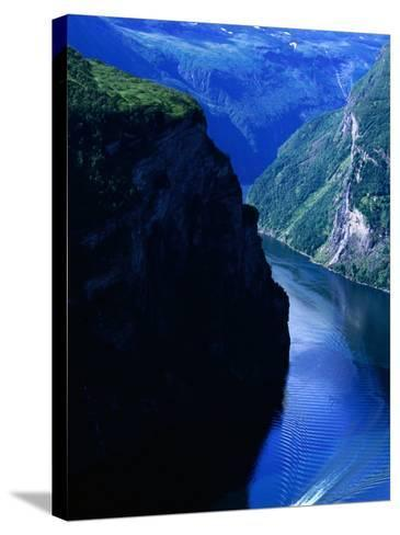 Fjord Ferry and Seven Sisters Waterfall, Geiranger, Norway-Anders Blomqvist-Stretched Canvas Print