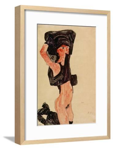 Kneeling Girl, Disrobing, 1910-Egon Schiele-Framed Art Print