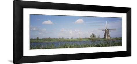 Traditional Windmill in the Village, Netherlands--Framed Art Print