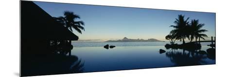 Silhouette of a Tourist Resort, Tahiti Beachcomber Resort, Papeete, Tahiti, French Polynesia--Mounted Photographic Print