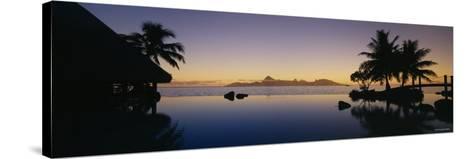 Silhouette of a Tourist Resort, Tahiti Beachcomber Resort, Papeete, Tahiti, French Polynesia--Stretched Canvas Print