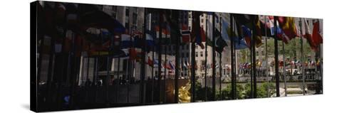 Flags in a Row, Rockefeller Plaza, Manhattan, New York, USA--Stretched Canvas Print