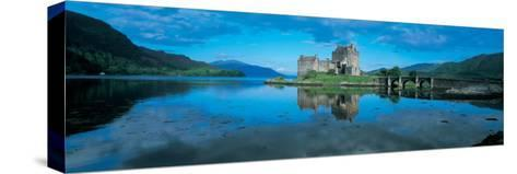 Reflection of a Castle in Water, Eilean Donan Castle, Loch Duich, Highlands, Scotland--Stretched Canvas Print