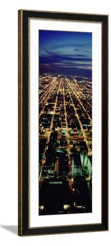 Building in a City Lit Up at Night, Chicago, Illinois, USA--Framed Art Print