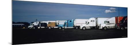 Semi-Trucks Parked on a Road, Ohio, USA--Mounted Photographic Print