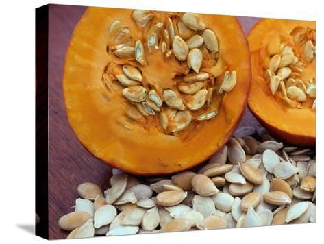 Sliced Pumpkin with Pumpkin Seeds (Cucurbita Sp) Europe-Reinhard-Stretched Canvas Print